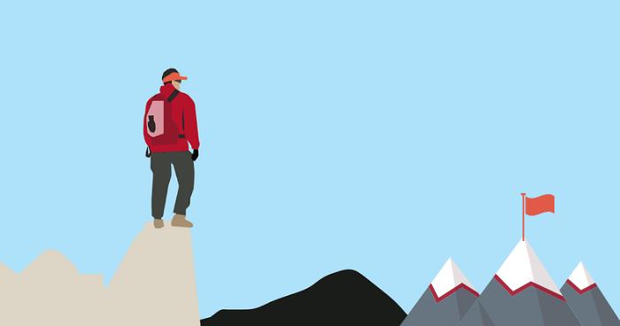 山頂を眺める人